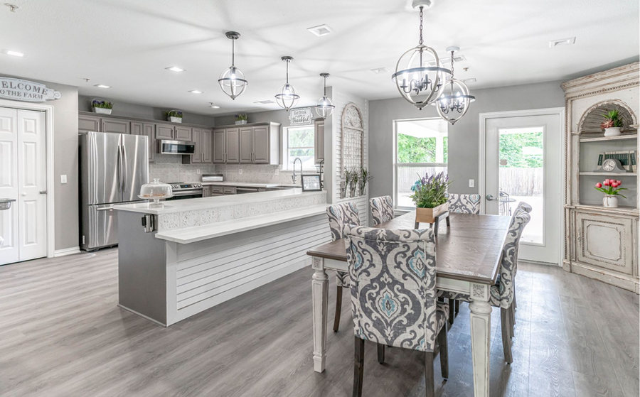 Family table style dining with open kitchen