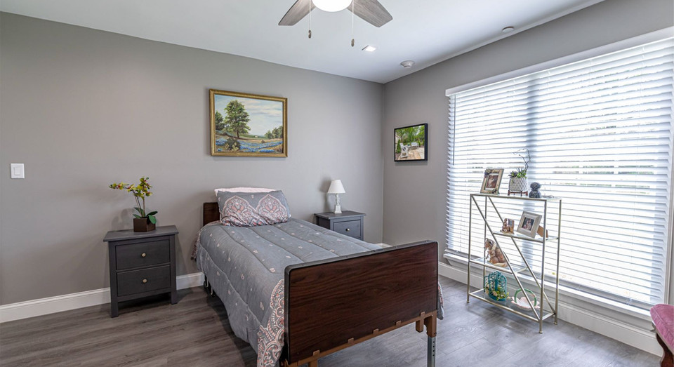 Assisted living resident room with single hospital-style bed