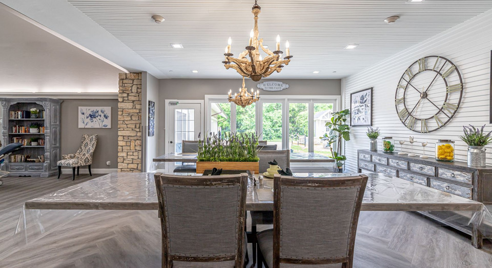 Dining table seating with large windows and cheerful decor