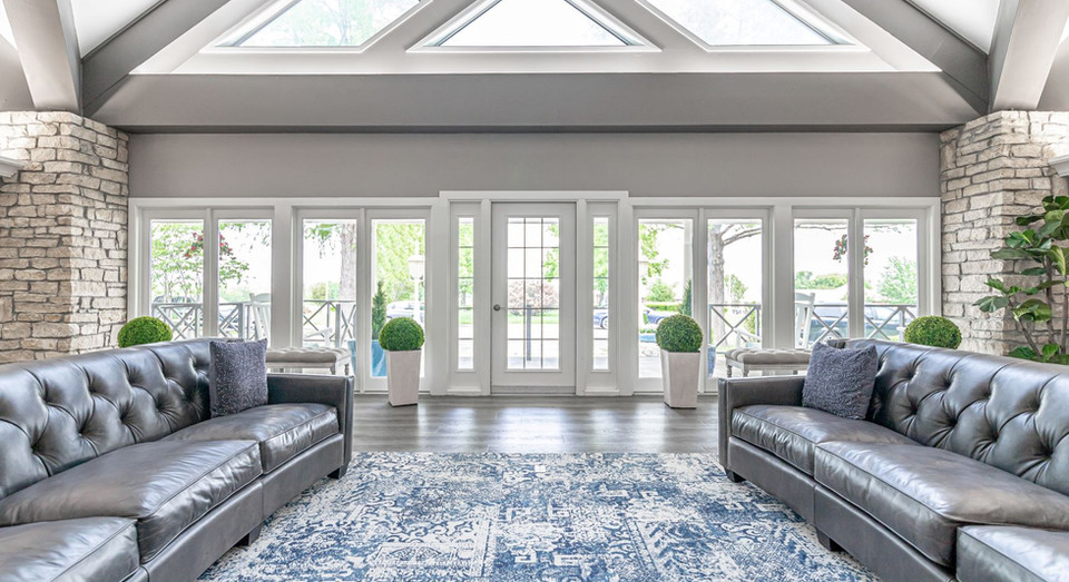 View of front doors and porch from inside large living room