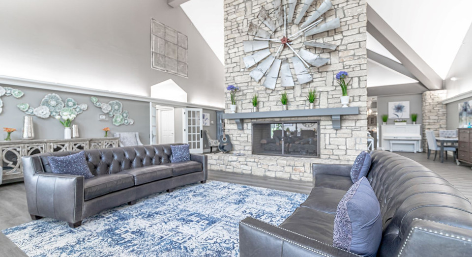 Grand, open living space with fireplace and high ceilings