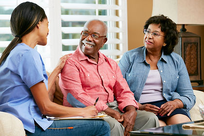Senior couple talking with friendly care