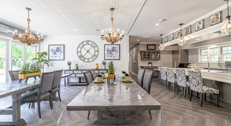 Bright open kitchen with multiple long tables and counter seating