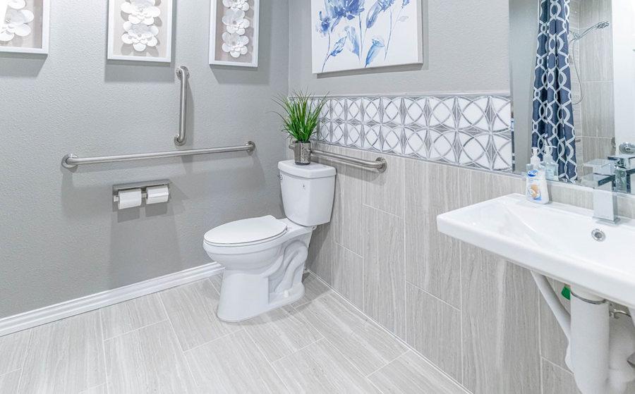 Spacious bathroom with safety rails
