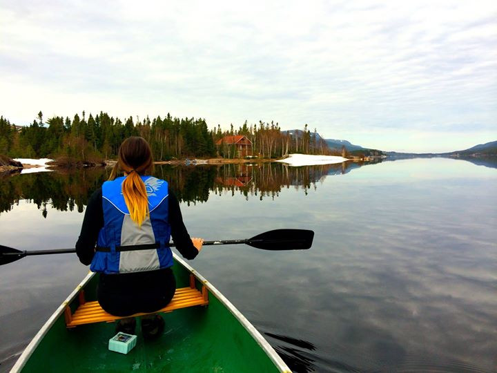Canoeing on a calm spring day. Birchy Lake, Newfoundland