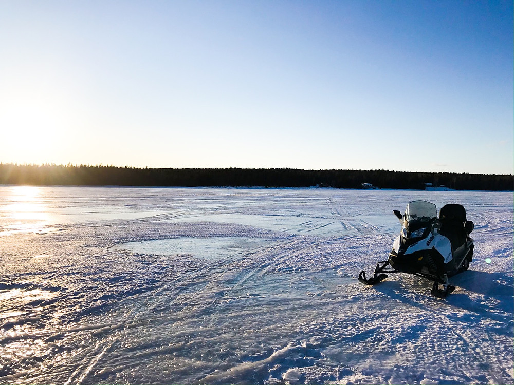 Skidoo parked on a lake for ice fishing