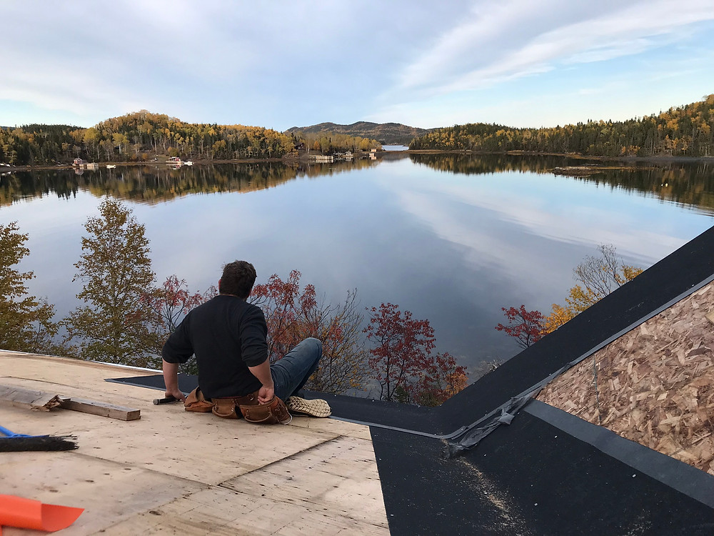 Installing ice and water shield on our diy cabin build roof