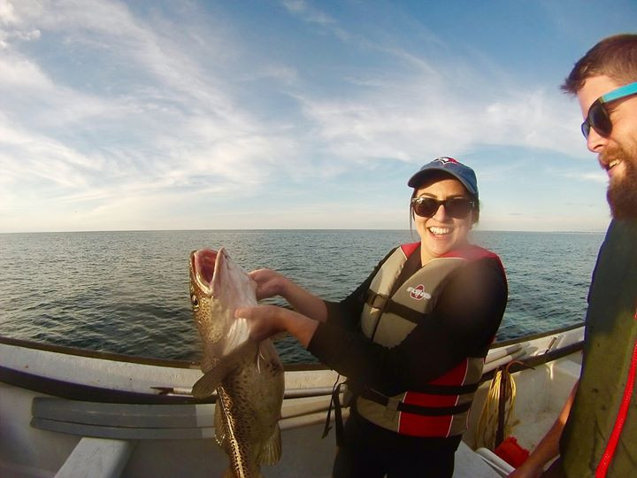Me in a boat holding a large cod by the gills. Caught near exploits island, Newfoundland and Labrador