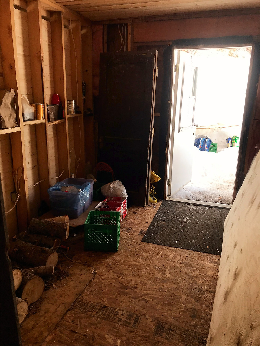 Unfinished mudroom in diy cabin
