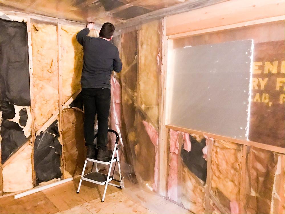 DIY cabin build, installing vapor barrier over insulation