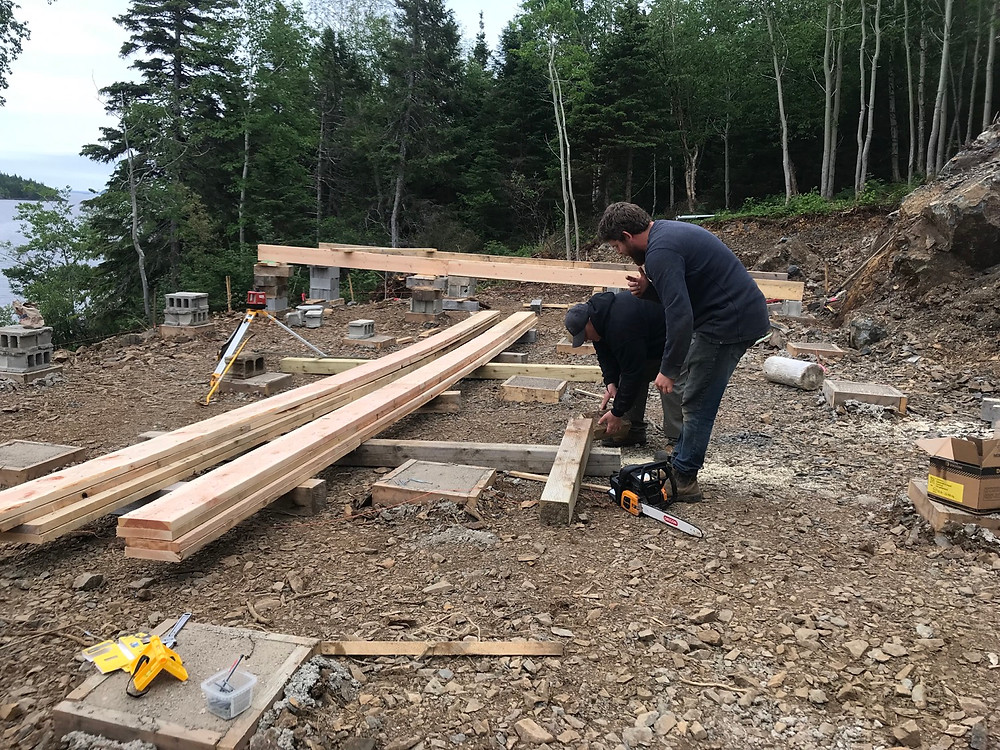 Laminating 2x10 lumber to make 26' long stringer support beams for our diy cabin foundation