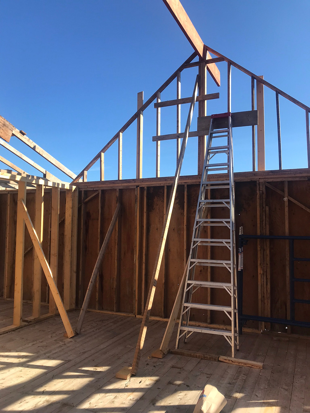 A ridge beam spanning from roof gables on our diy cabin build