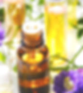 essential oil bottle with flowers