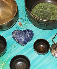 Sound Healing tools: tibetal bowls, tingshas, crystals