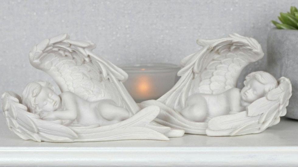 Pair of sleeping cherub wrapped in angel wings