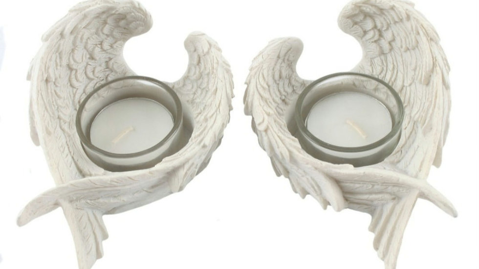 Winged candle holders