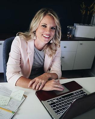 solopreneuer working at desk with macbook pro muncie branding photographer