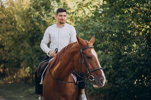 handsome-man-riding-horse-forest.jpg