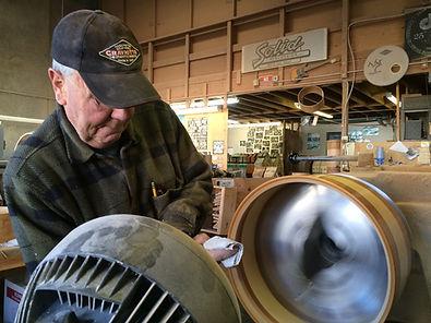 Johnny Craviotto polishing a shell.