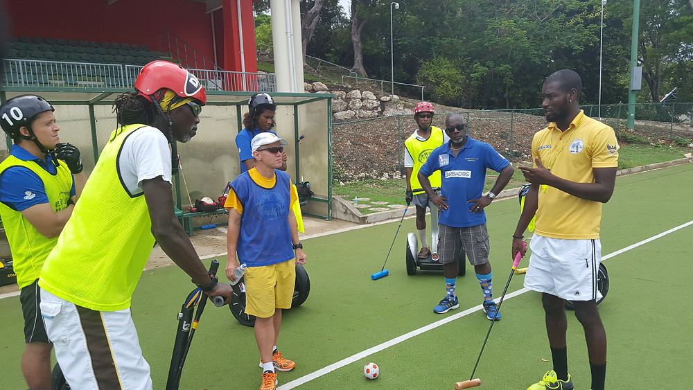 Nevin Roach (yellow) discussing game strategies with players