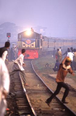 Pilgrims wait for train