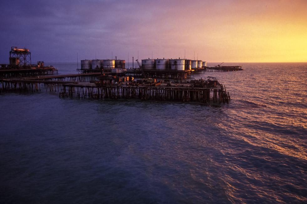 Storage tanks at sunset