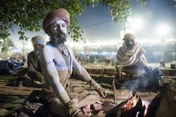 Naga sadhu by his fire