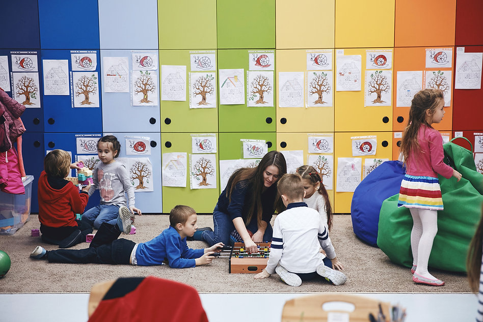 Children playing together in a colorful room with drawings on the walls