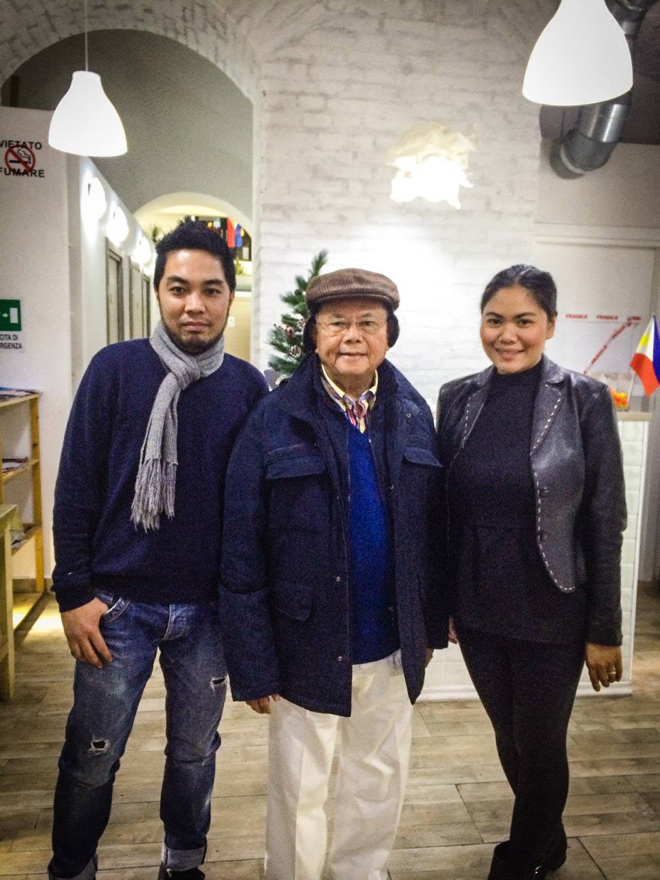Claire Datu, right, with her co-owner and husband Reinnar, left, and a regular customer in their restaurant. (Photo courtesy Claire Datu)