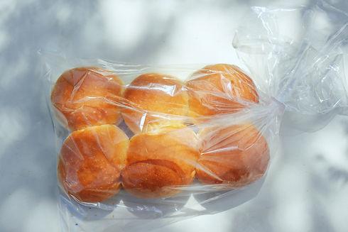 pack of white dinner rolls in dappled sh