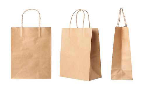 Brown paper shopping bags isolated on wh
