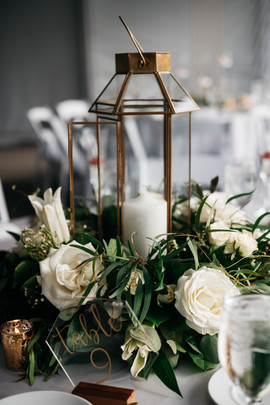 Floral centerpiece with table number