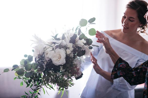 Bride admiring her bouquet