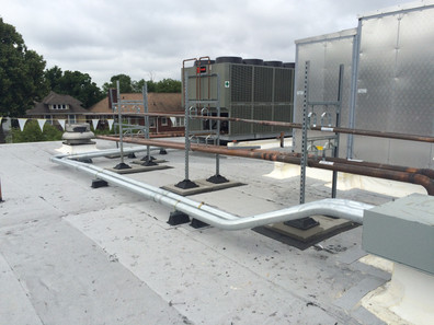 School 7 Commissioning Rooftop with Pipe