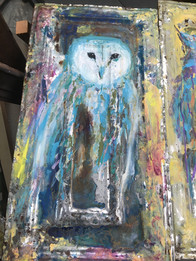 Painted owl on aged tin