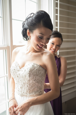 Bride getting ready with wedding dress | THE ONE BRIDAL