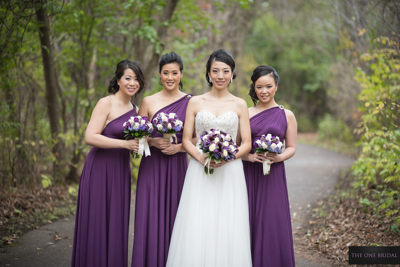 bride and bridesmaid with bouquets   THE ONE BRIDAL