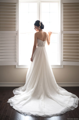 Bride getting ready with wedding dress   THE ONE BRIDAL