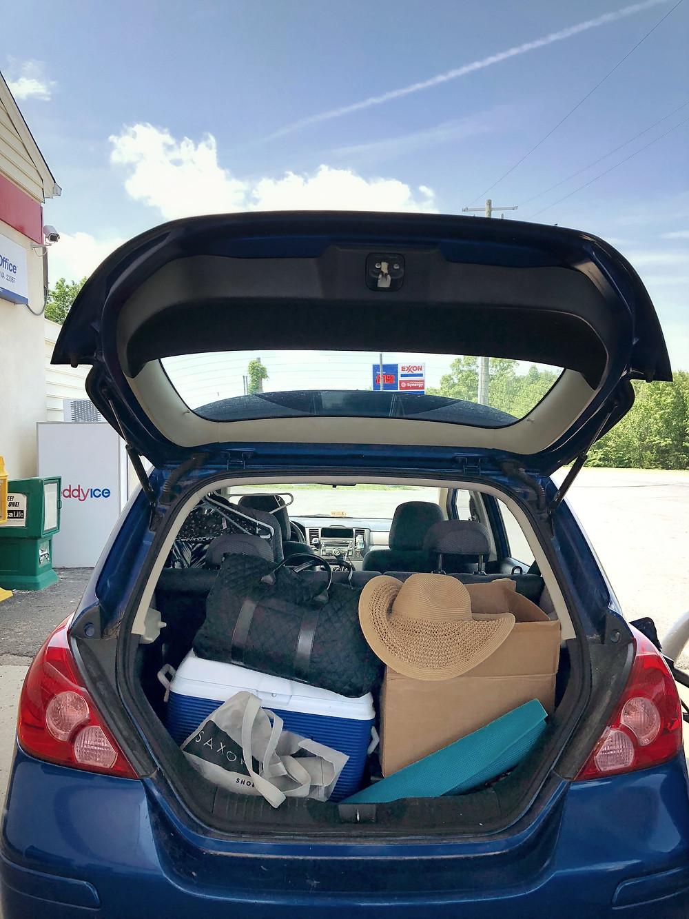 blue car on road trip