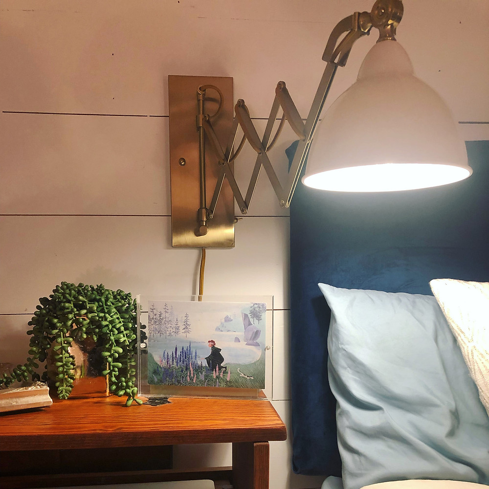 Bedside lamp Target gold and white accents blue upholstered headboard