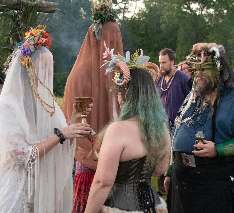 The blessing of the attendees by the May Queen and Oak King 2019