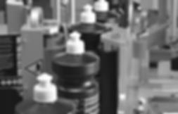 Vollautomatische Rundumetikettierung von zylindrischen Flaschen