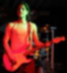 Sheron playing guitar in a bar