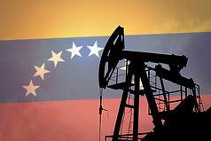 Oil pump on background of flag of Venezu