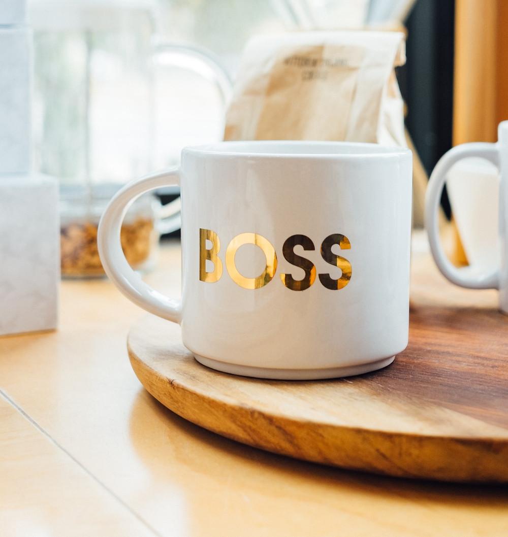 A mug that spells out boss.