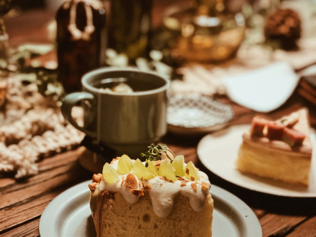 HAPPINESS is a giant piece of a delicious cake with a cup of tea.