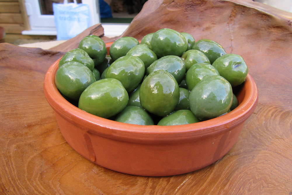 A whole Olive, from Sicily, firm, sweet and mild. Lightly coated in oil. These eye catching bright green olives are crisp and creamy towards the stone.