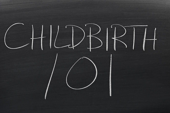 The words _Childbirth 101_ on a blackboa