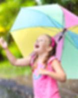 kids with umbrella.jpg