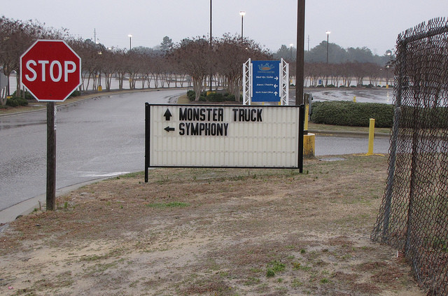 Sign pointing to Monster Truck and Symphony events